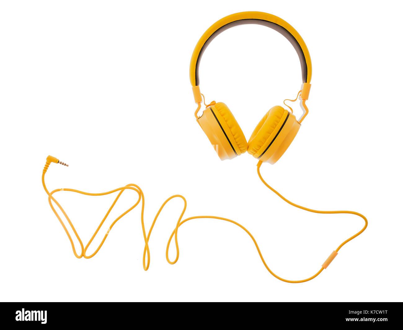 Casque écouteur jaune ou ordinateur isolé sur fond blanc Photo Stock