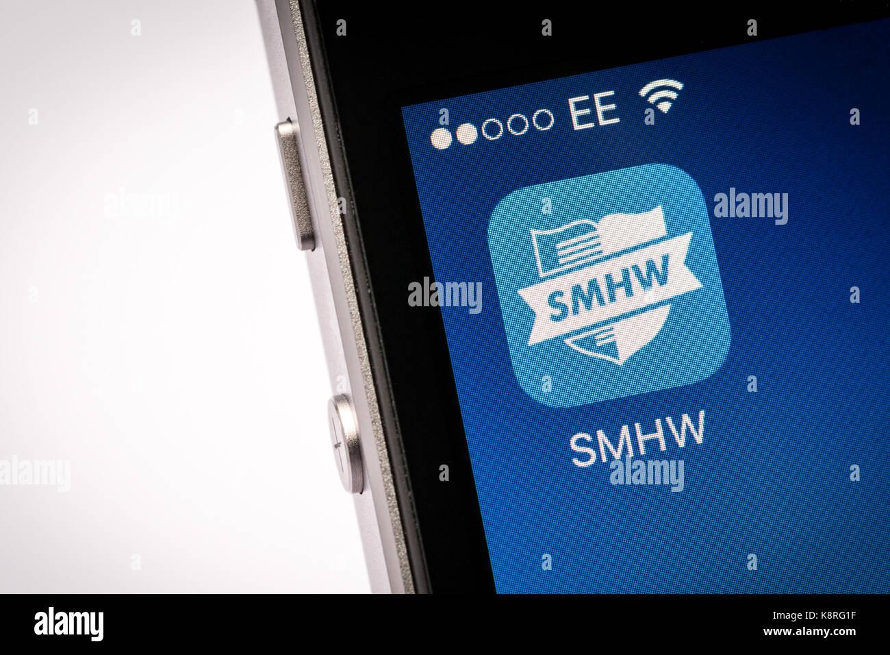 SMHW montrer mon travail à domicile app sur un iPhone téléphone mobile Photo Stock