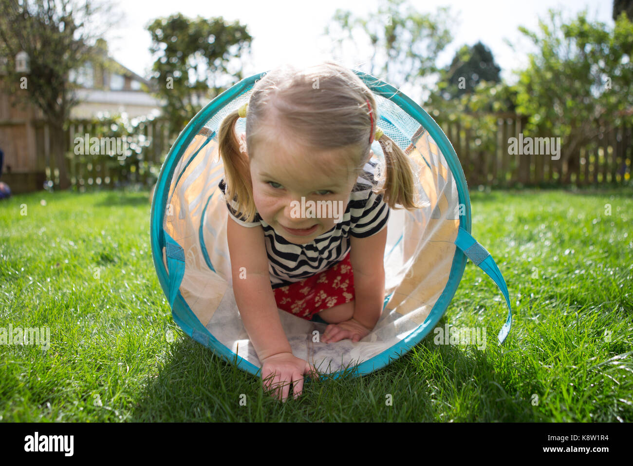 Little girl playing in garden Photo Stock