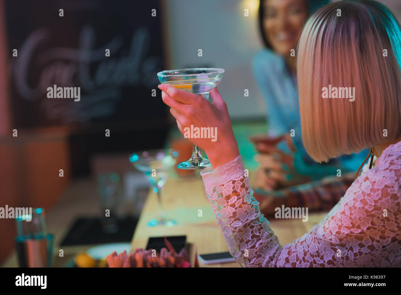 Woman holding cocktail Photo Stock