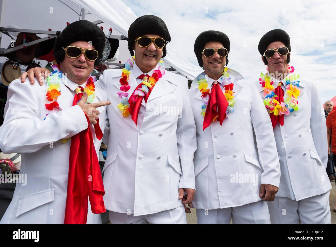 Elvis regarder-un-aime (de gauche à droite) David Lee, Chris Lester, 'Factory Phil' et Dean Sullivan Photo Stock