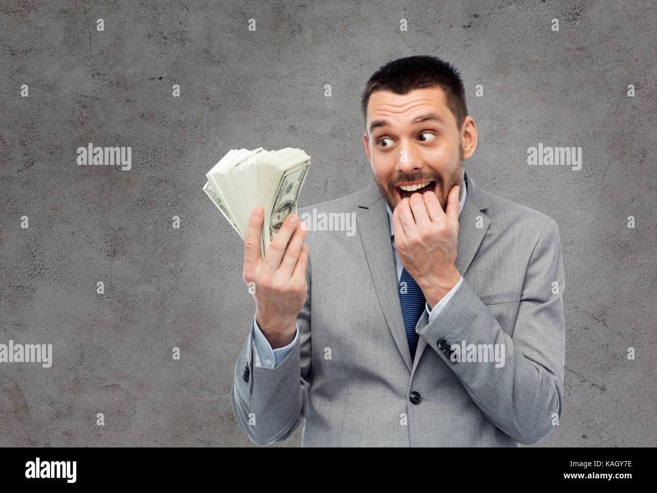 Homme d'affaires avide avec american dollar argent Photo Stock