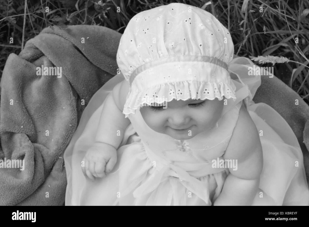 Baby Wearing Bonnet Photos   Baby Wearing Bonnet Images - Alamy 84eb2e59f88