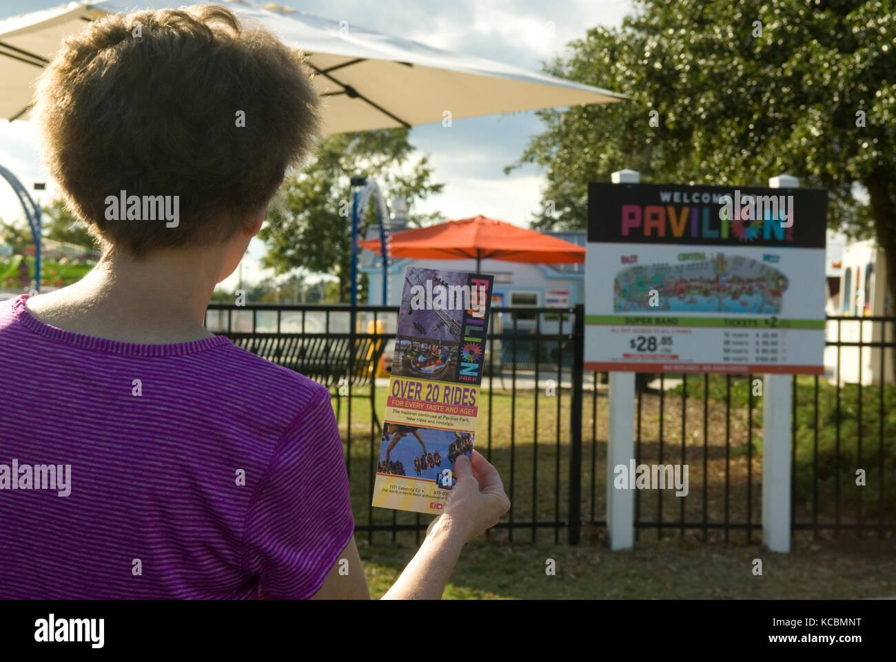 Woman holding brochure Parc Pavilion Myrtle Beach SC, USA. Photo Stock