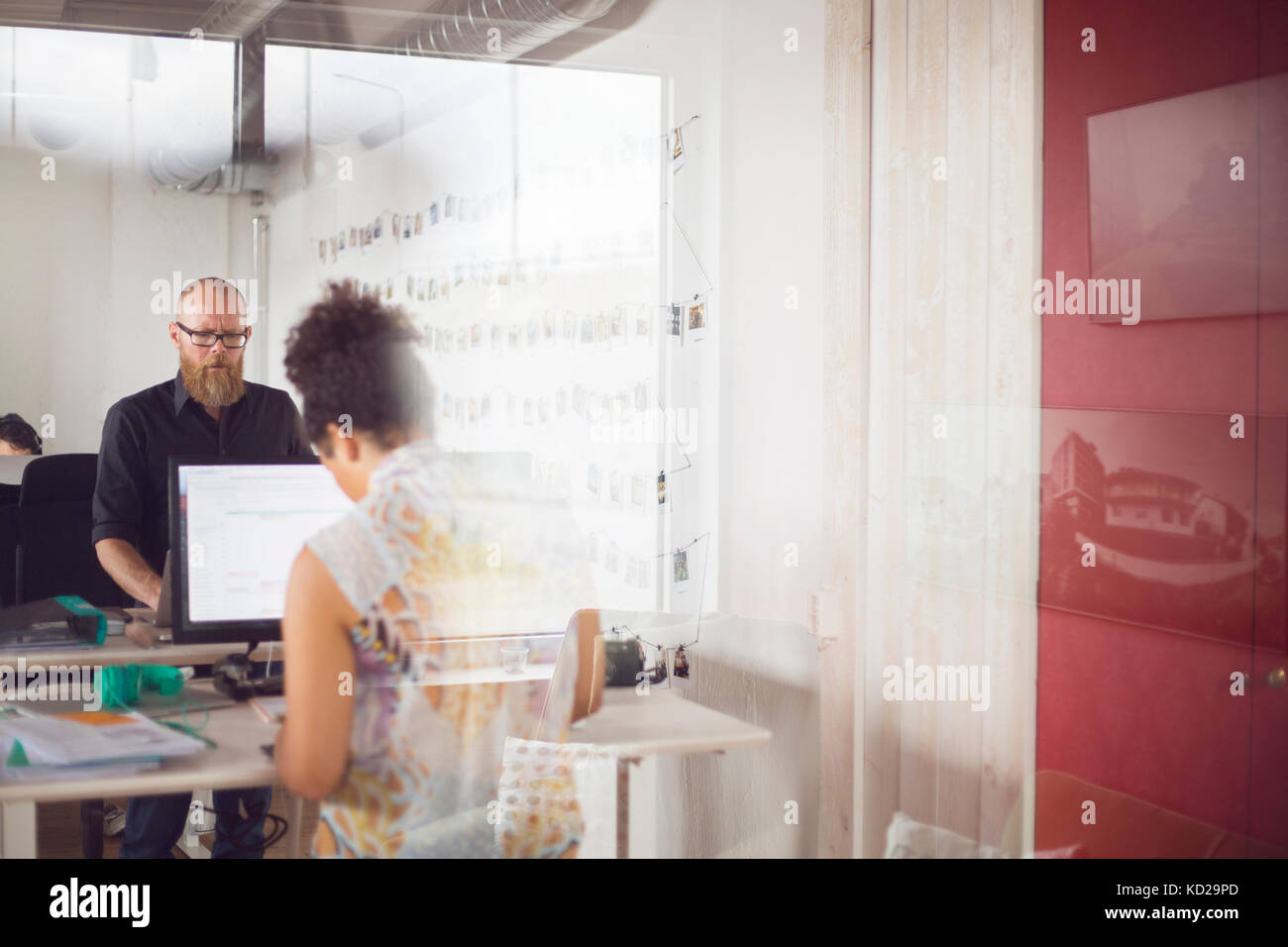 Man and Woman working in office Photo Stock