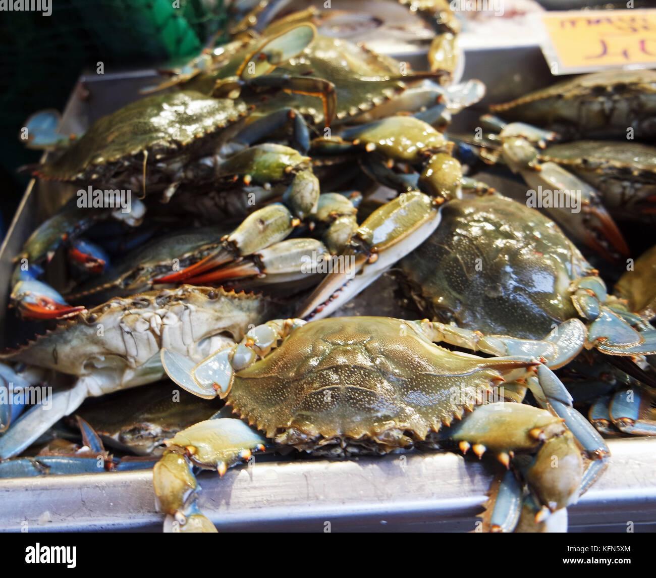 Les pêcheurs de crabes vendus dans Photo Stock