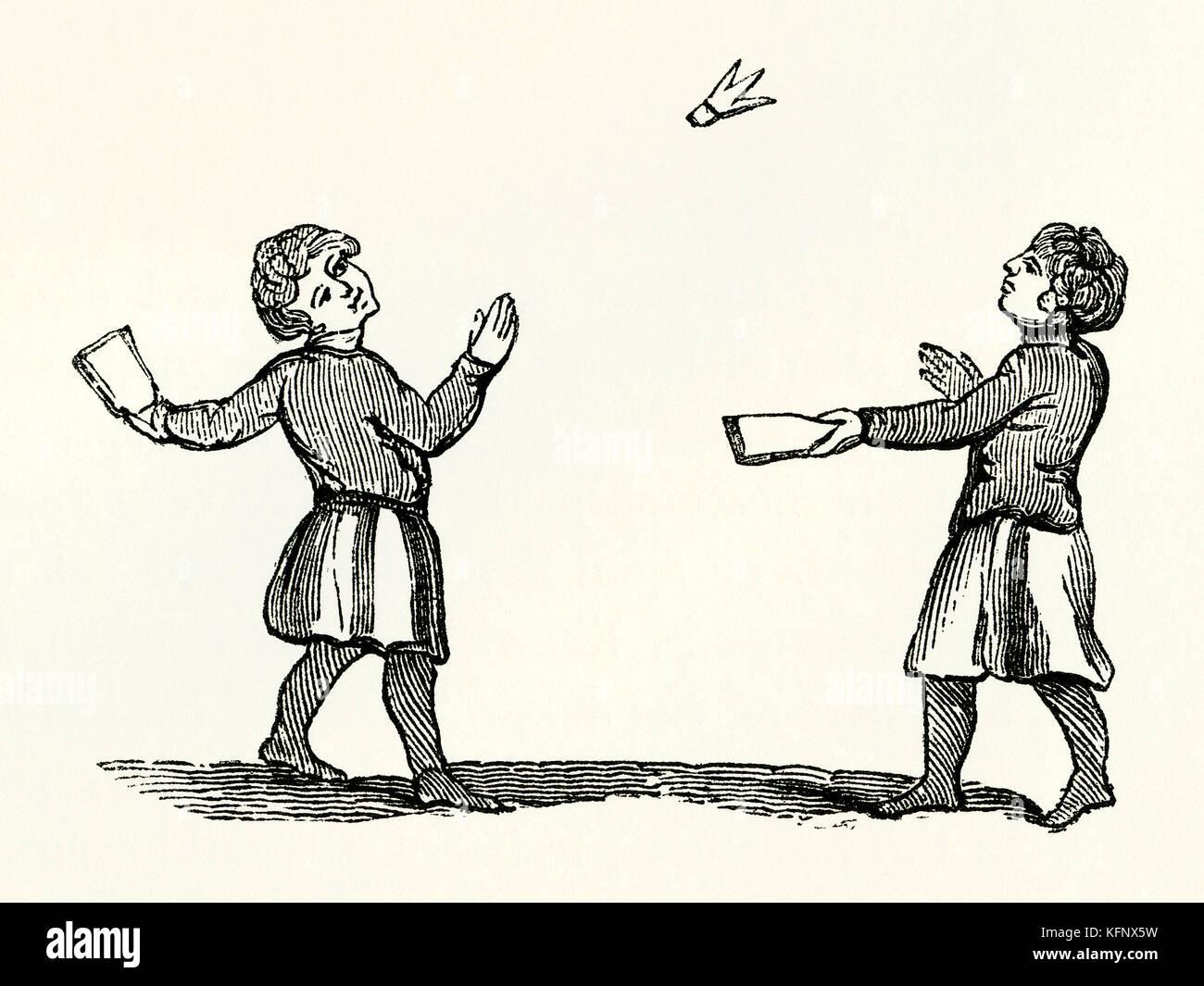 Une vieille gravure médiévale de battledore et volant, ou jeu de volant, un début de jeu liées Photo Stock