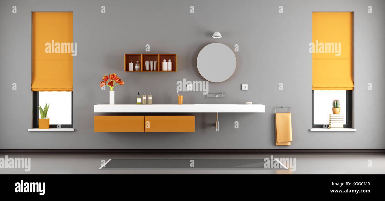 Gris et orange, une salle de bains moderne avec lavabo ...