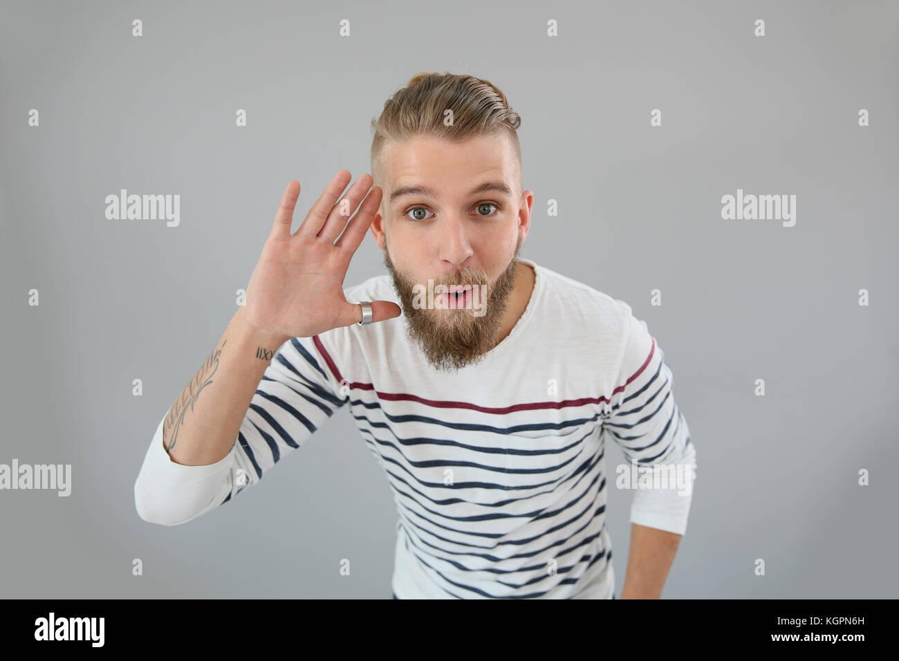 L'homme avec l'étonnement d'oeil, isolé Photo Stock