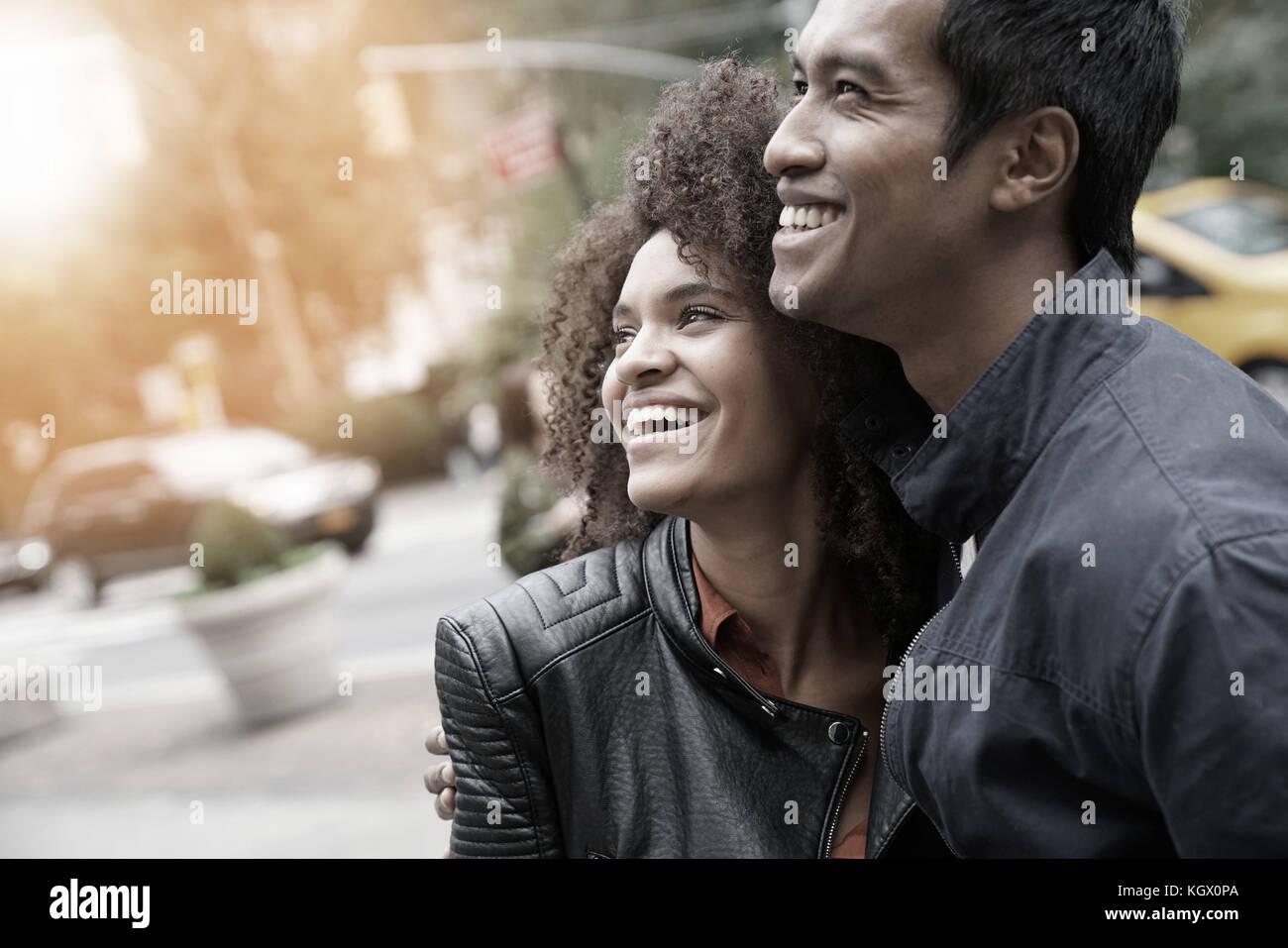 Ethnic couple walking in new york city street Photo Stock