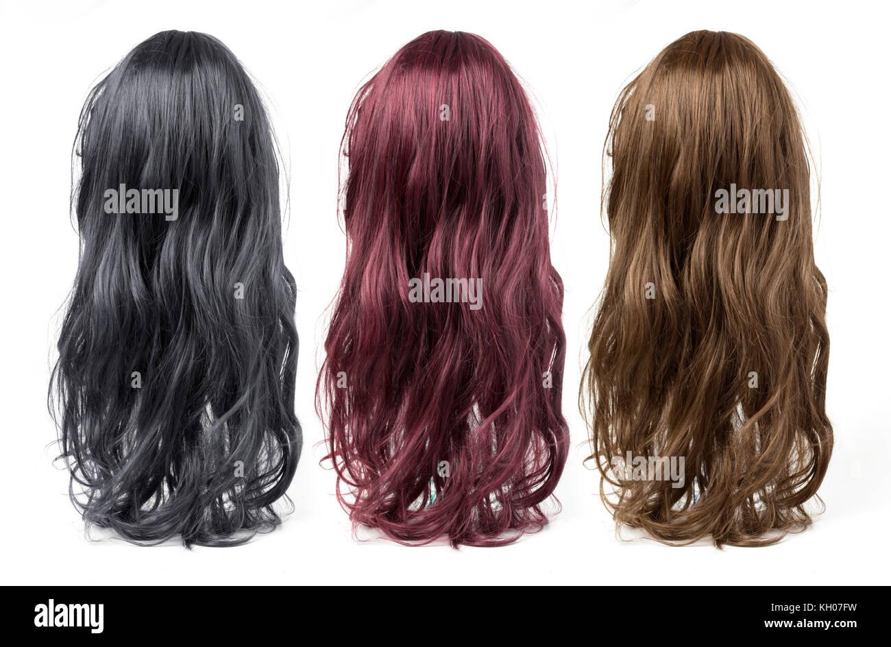 Ensemble de longues perruques bouclées sur un fond blanc Photo Stock