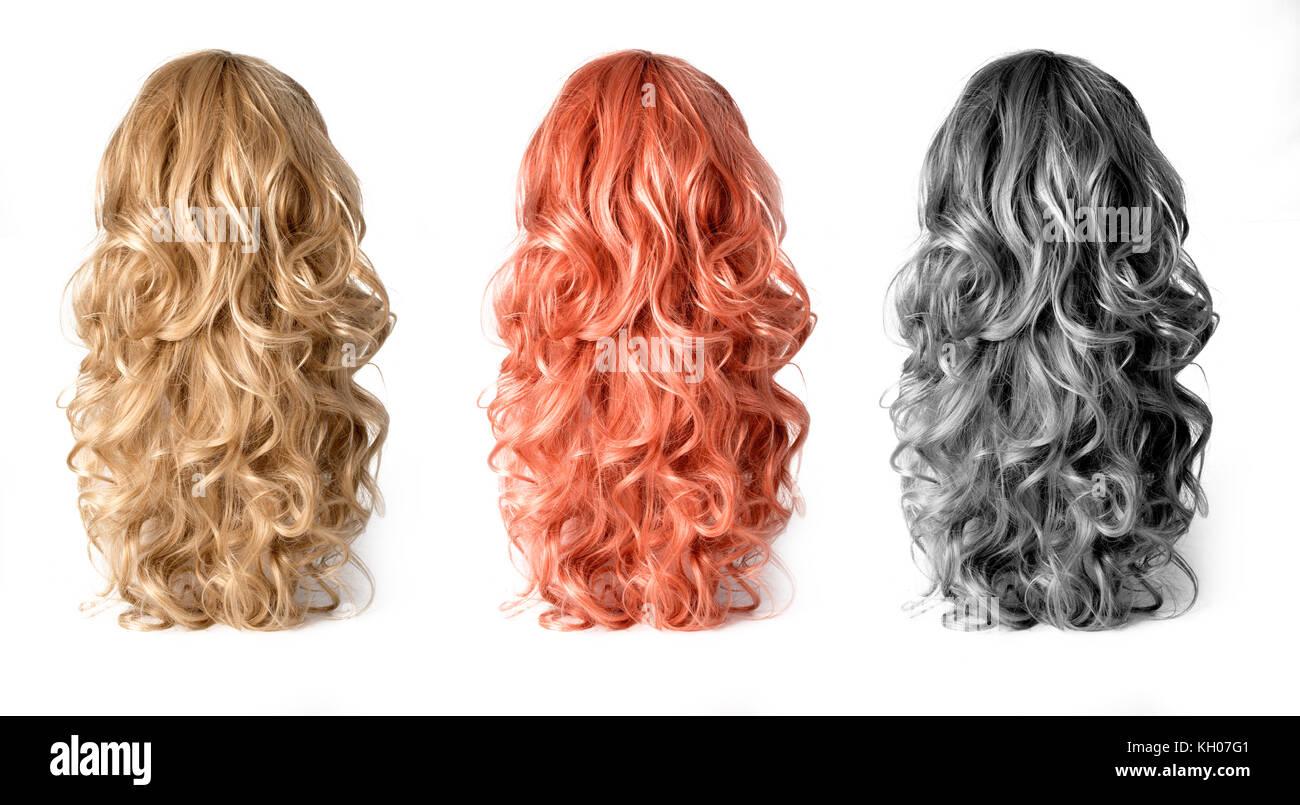 Ensemble de longues perruques cheveux isolé sur fond blanc Photo Stock