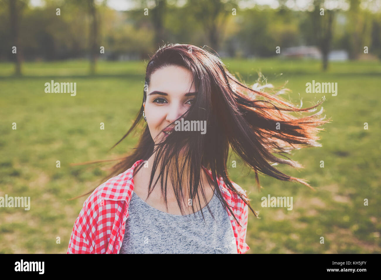 Hipster attractive girl smiling in wind Photo Stock