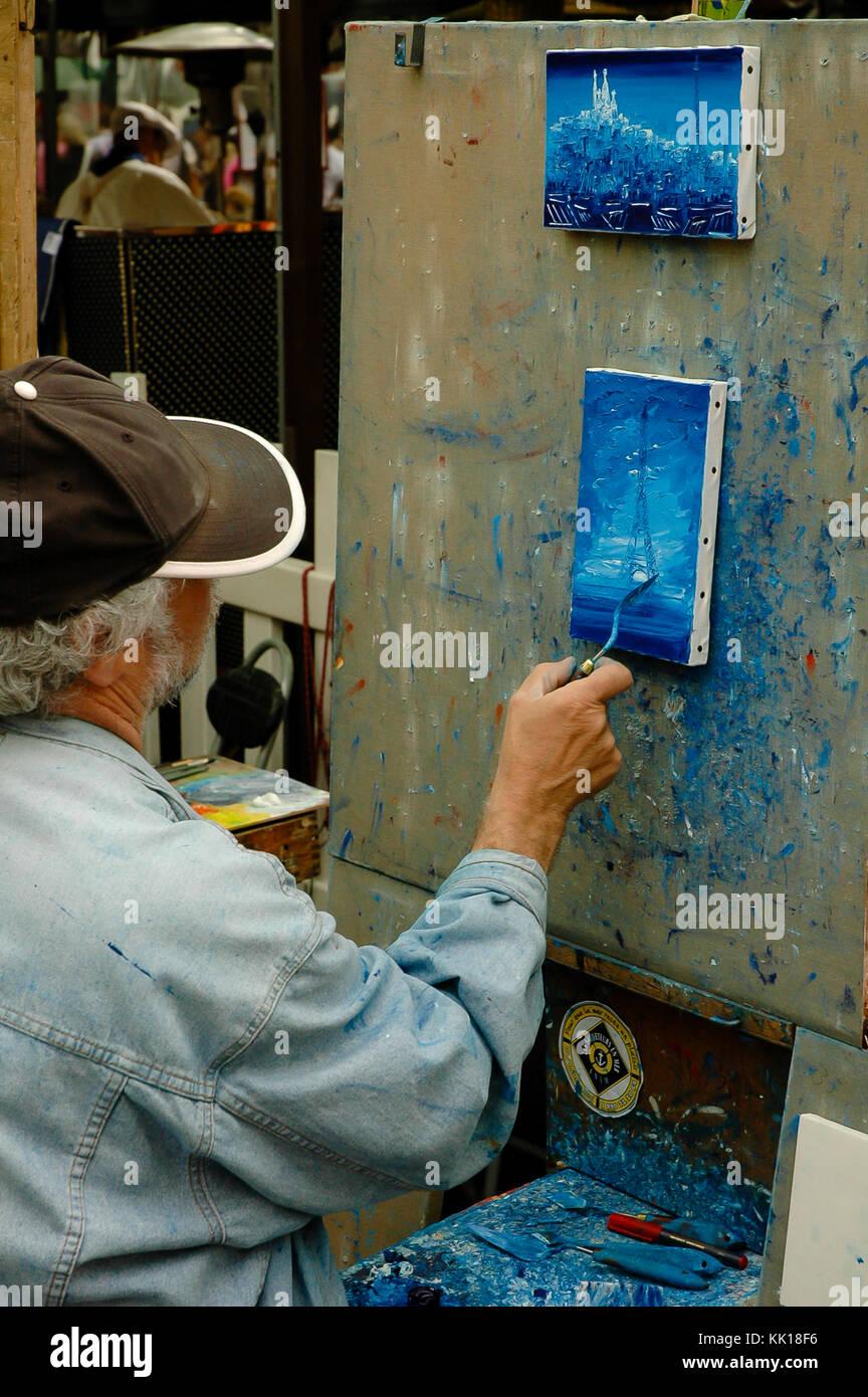 La peinture d'artistes et vente de peintures pour les touristes au trimestre d'artistes à Montmartre sur le chemin de la Basilique du Sacré-Cœur de Paris Banque D'Images