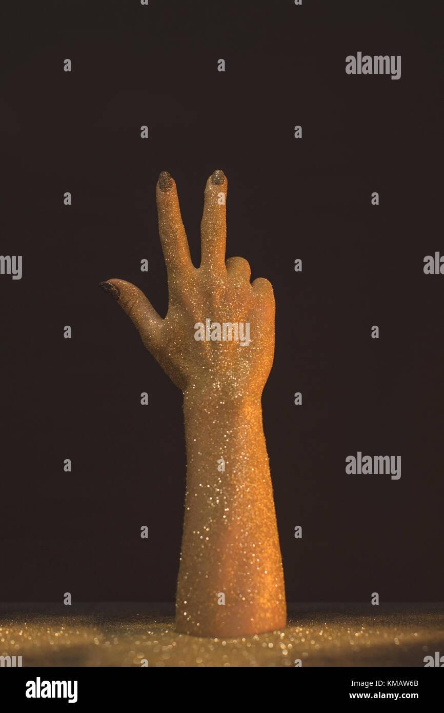 La main de cire montrant trois doigts Photo Stock