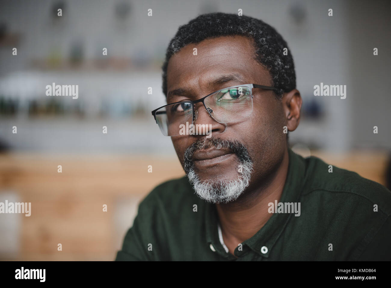 Young african american man in bar Photo Stock