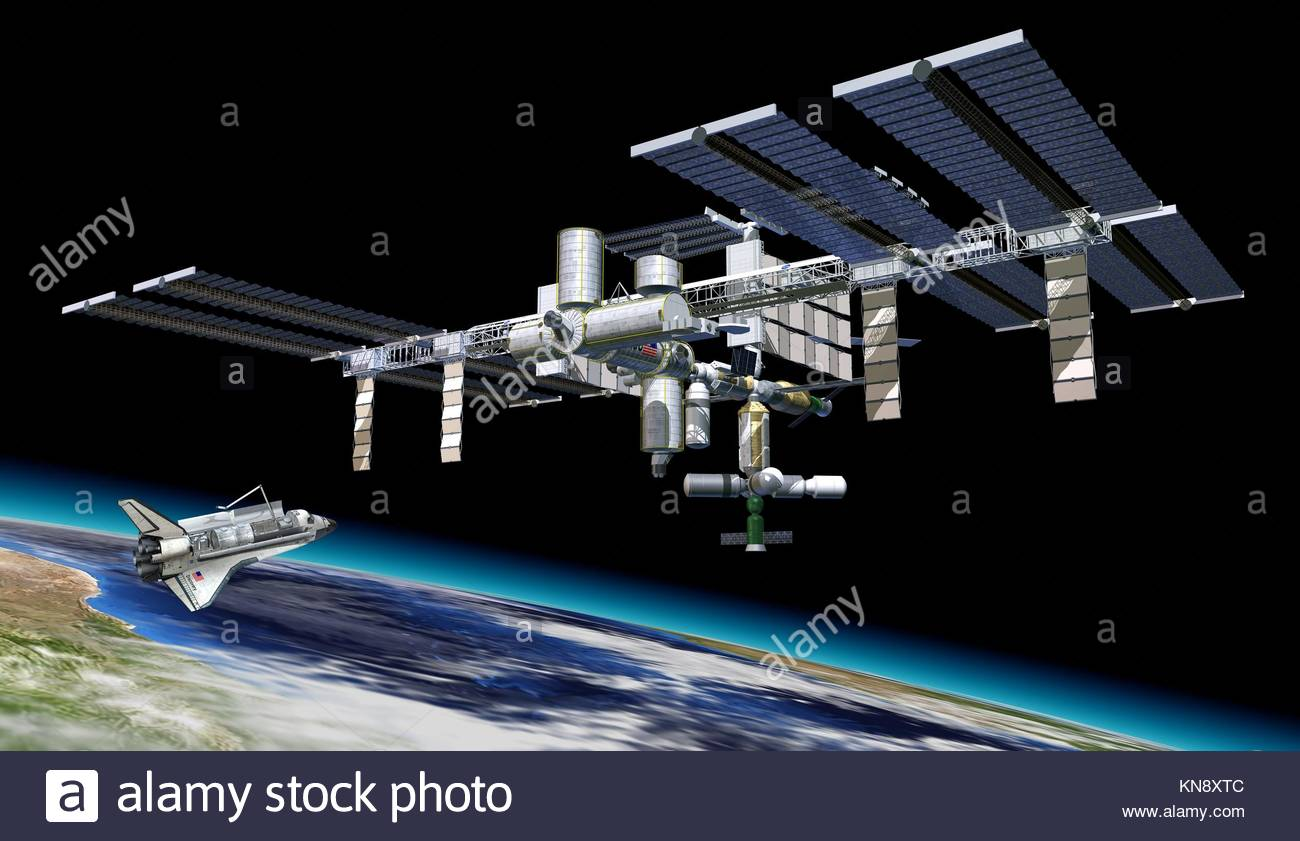 Station spatiale en orbite autour de la Terre, à l'aéroport. Une partie de la terre en bas. Photo Stock