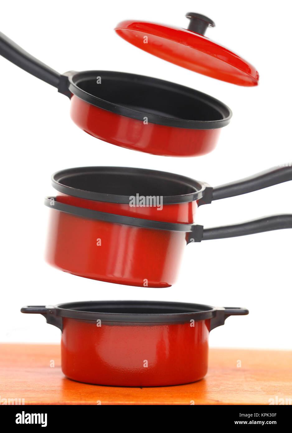 L'ensemble de cuisson rouge sur fond blanc Photo Stock