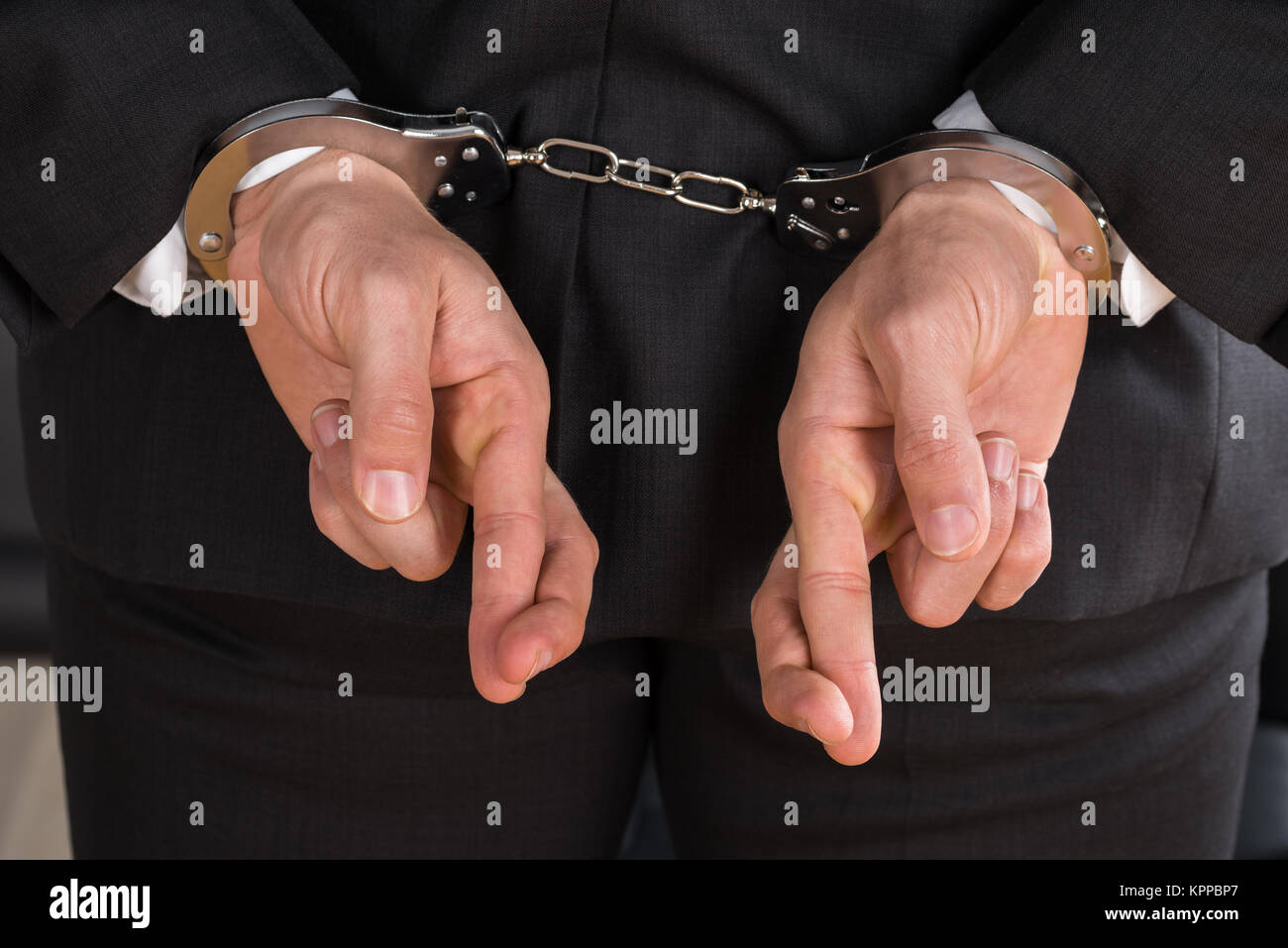 Businessman With Handcuffs Photo Stock