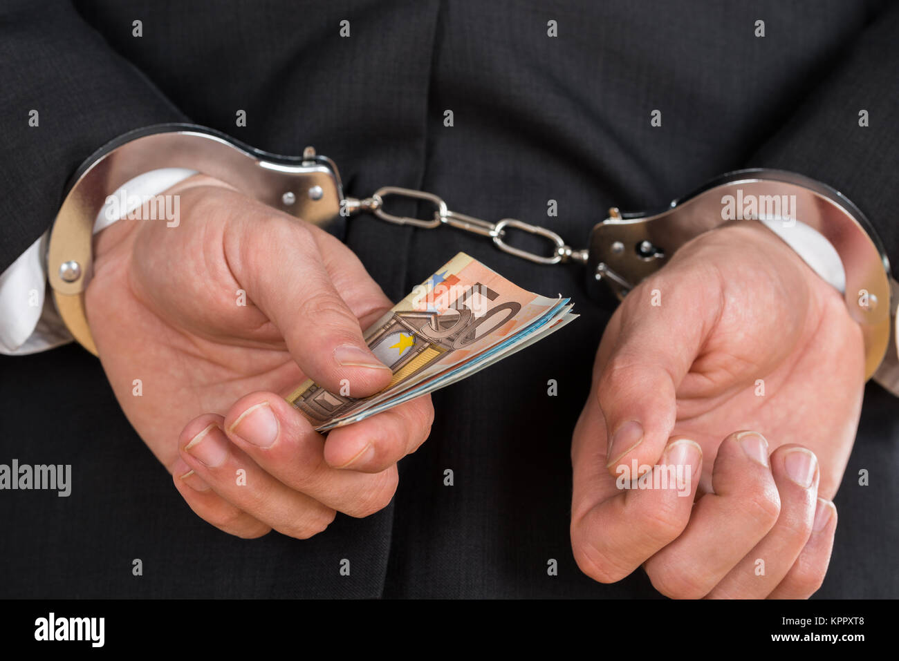 Close-up of Businessman in Handcuffs Photo Stock