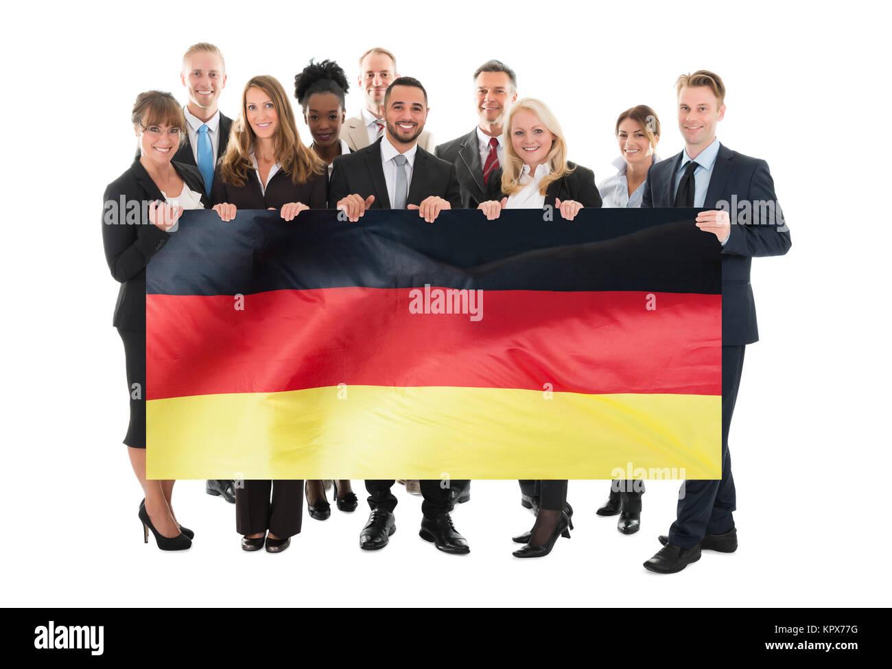 Convaincus de l'Équipe Entreprises ethniques multiples Holding Blank Billboard Photo Stock