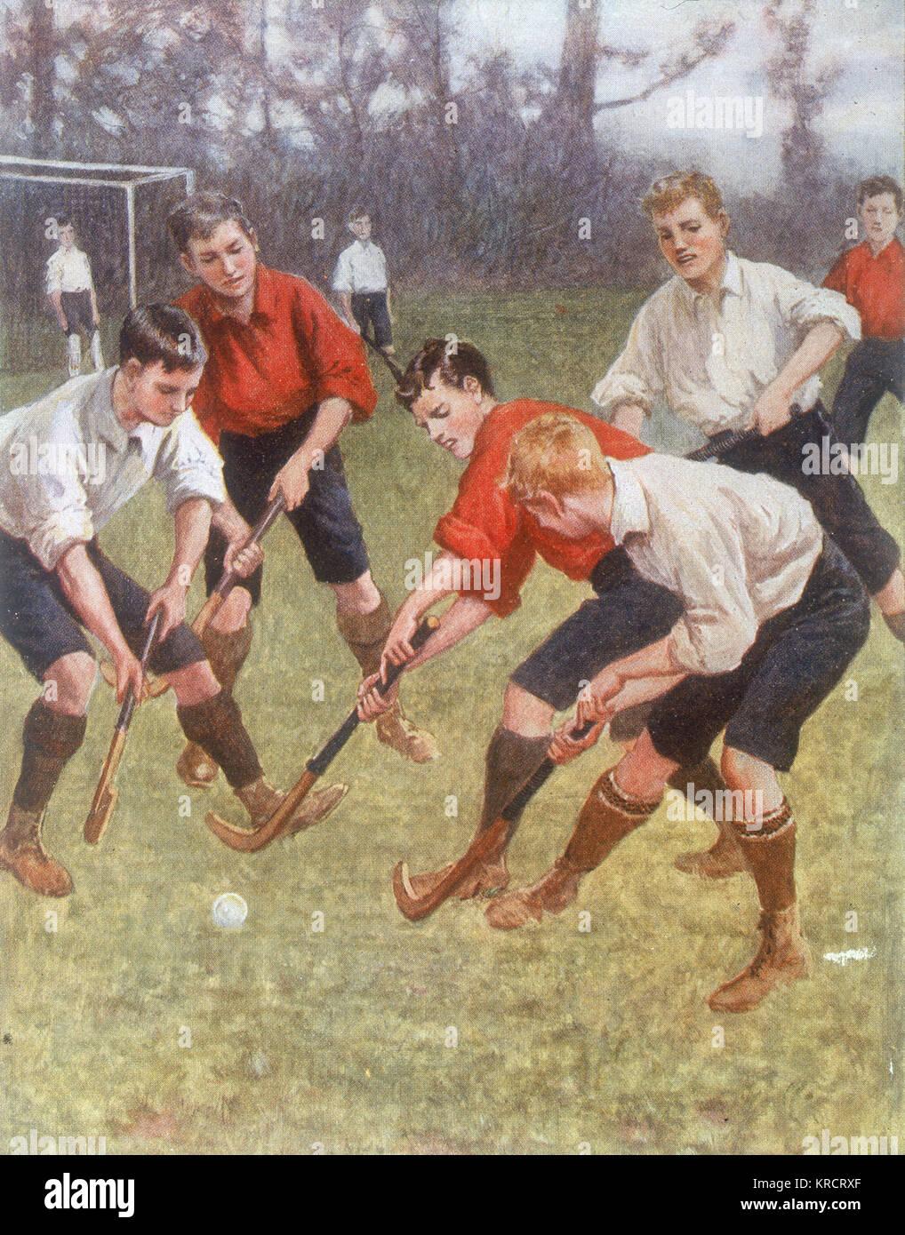 Un match de hockey des garçons Date: 1908 Photo Stock