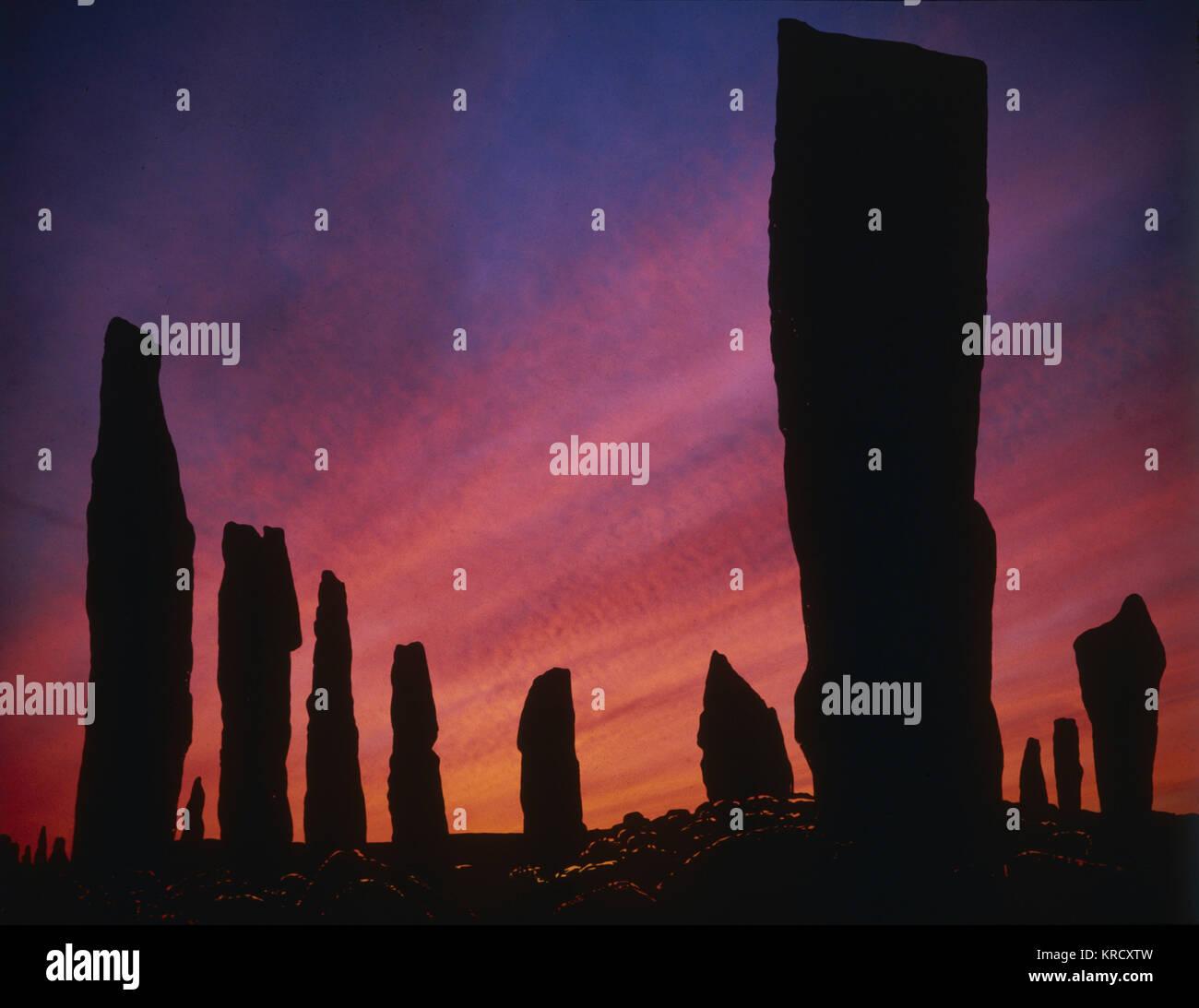 Coucher de soleil sur l'ancien comité permanent de Callanish stones Stone Circle, Isle Of Lewis, Hébrides Photo Stock