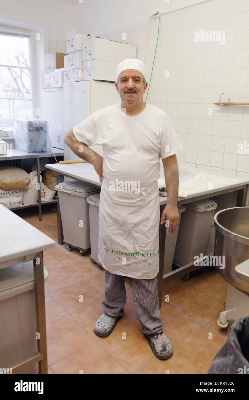 Portrait du chef en cuisine Photo Stock