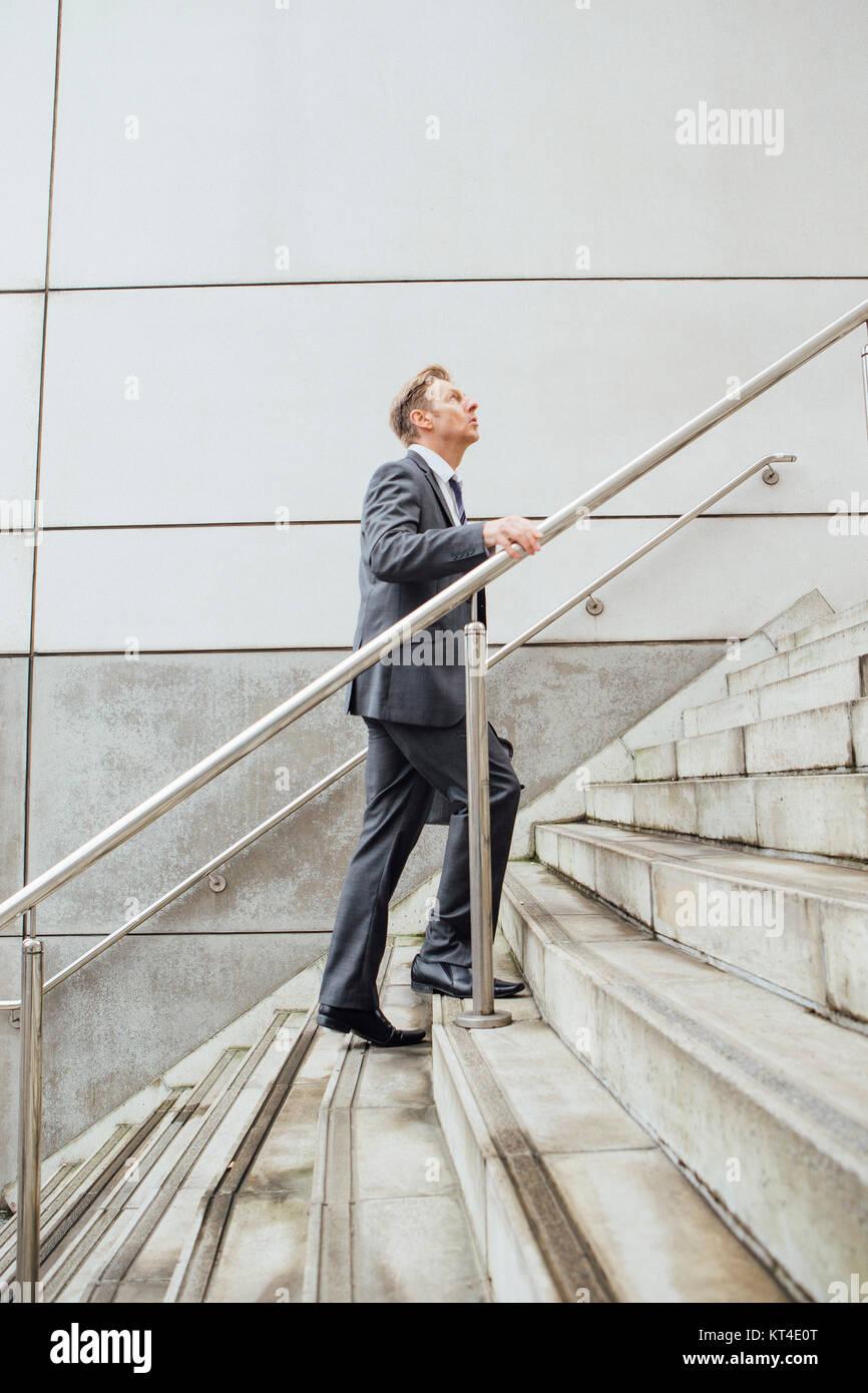 Businessman dans l'escalier Photo Stock