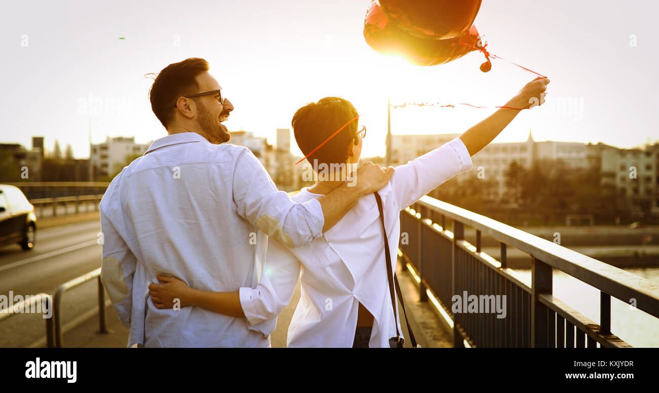 Young couple in love dating and smiling outdoor Photo Stock