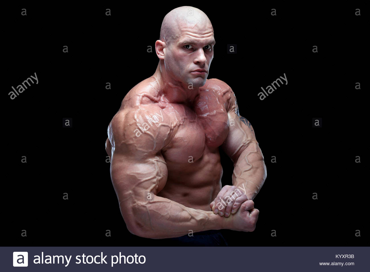 Beau mâle musclé posing in front of black background Photo Stock