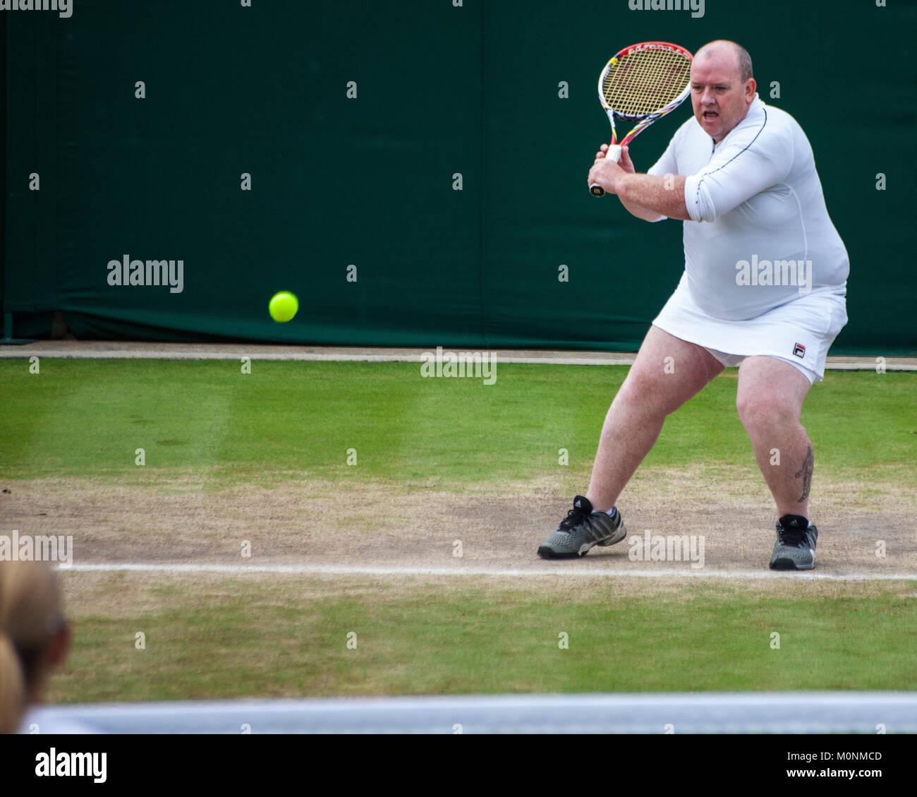 Kim Clijsters avait un ventilateur mâles mis sur une jupe et jouer un point à Wimbledon 2017 Sur invitation Photo Stock