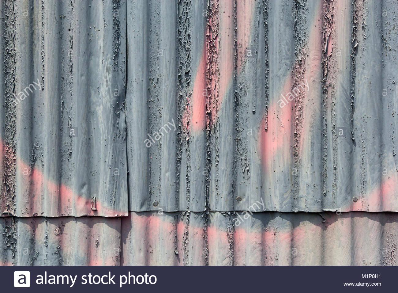 L écaillage De La Peinture Gris Et Rose Graffiti Sur Un Mur