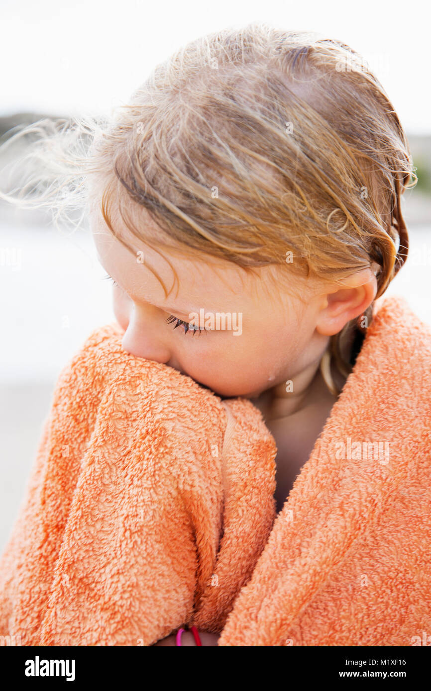 Girl wrapped in towel at, Bohuslan, Sweden Photo Stock