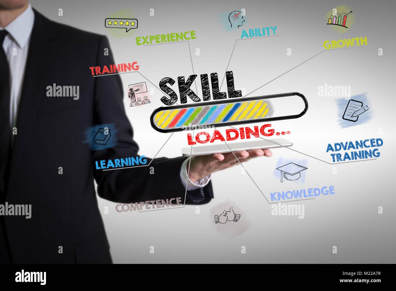 Concept de compétences avec young man holding a tablet computer Photo Stock