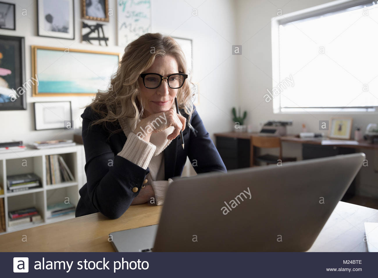 Entrepreneur Senior businesswoman working at laptop in office studio Photo Stock