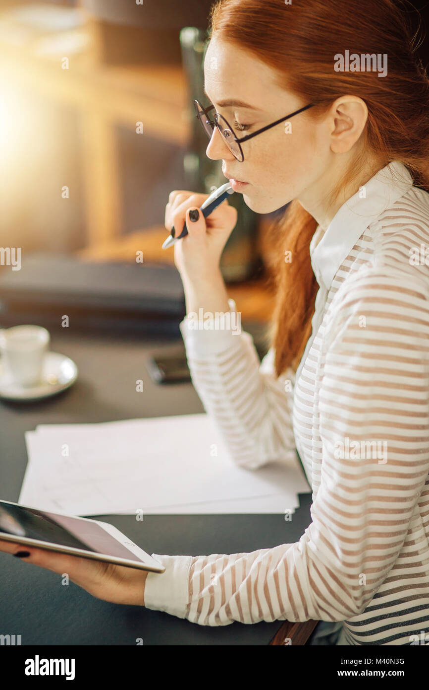 Young businesswoman using tablet computer Photo Stock