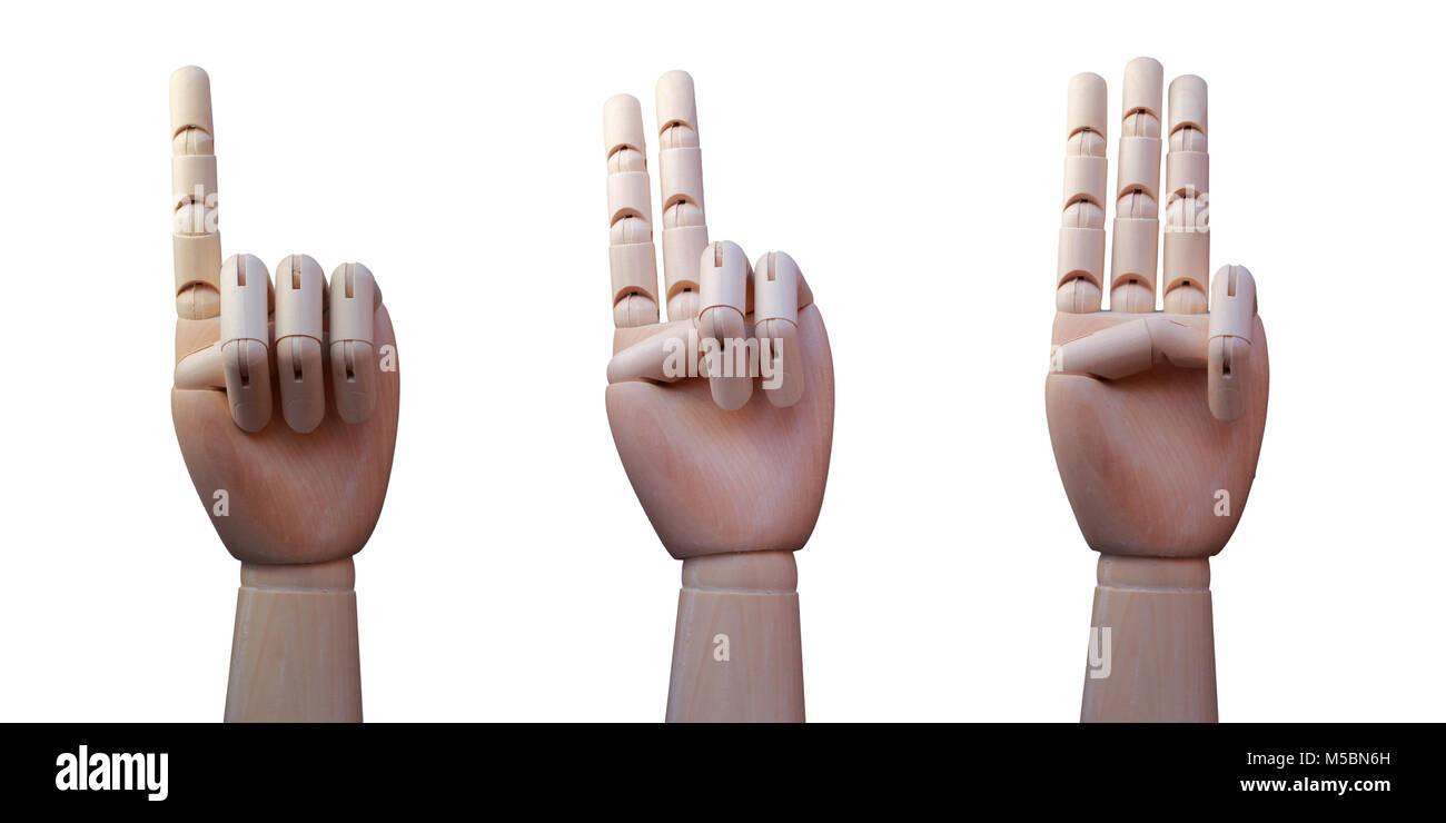 Trois mains en bois, avec un, deux et trois doigts soulevées respectivement, isolé sur fond blanc Photo Stock