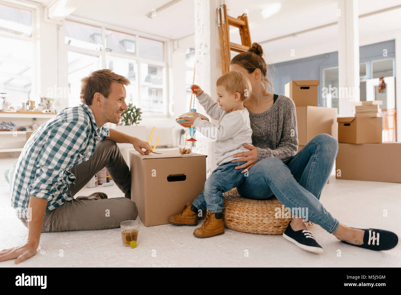 Happy Family moving into new home Photo Stock