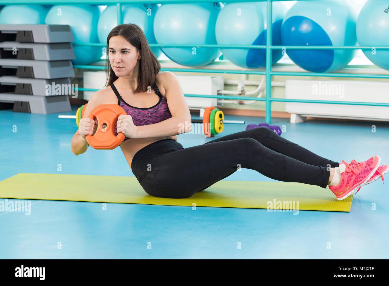 Jeune femme à l'exercice de sport Photo Stock