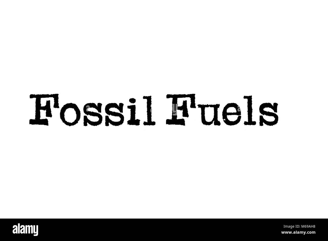 Le mot des combustibles fossiles, une machine à écrire sur un fond blanc Banque D'Images