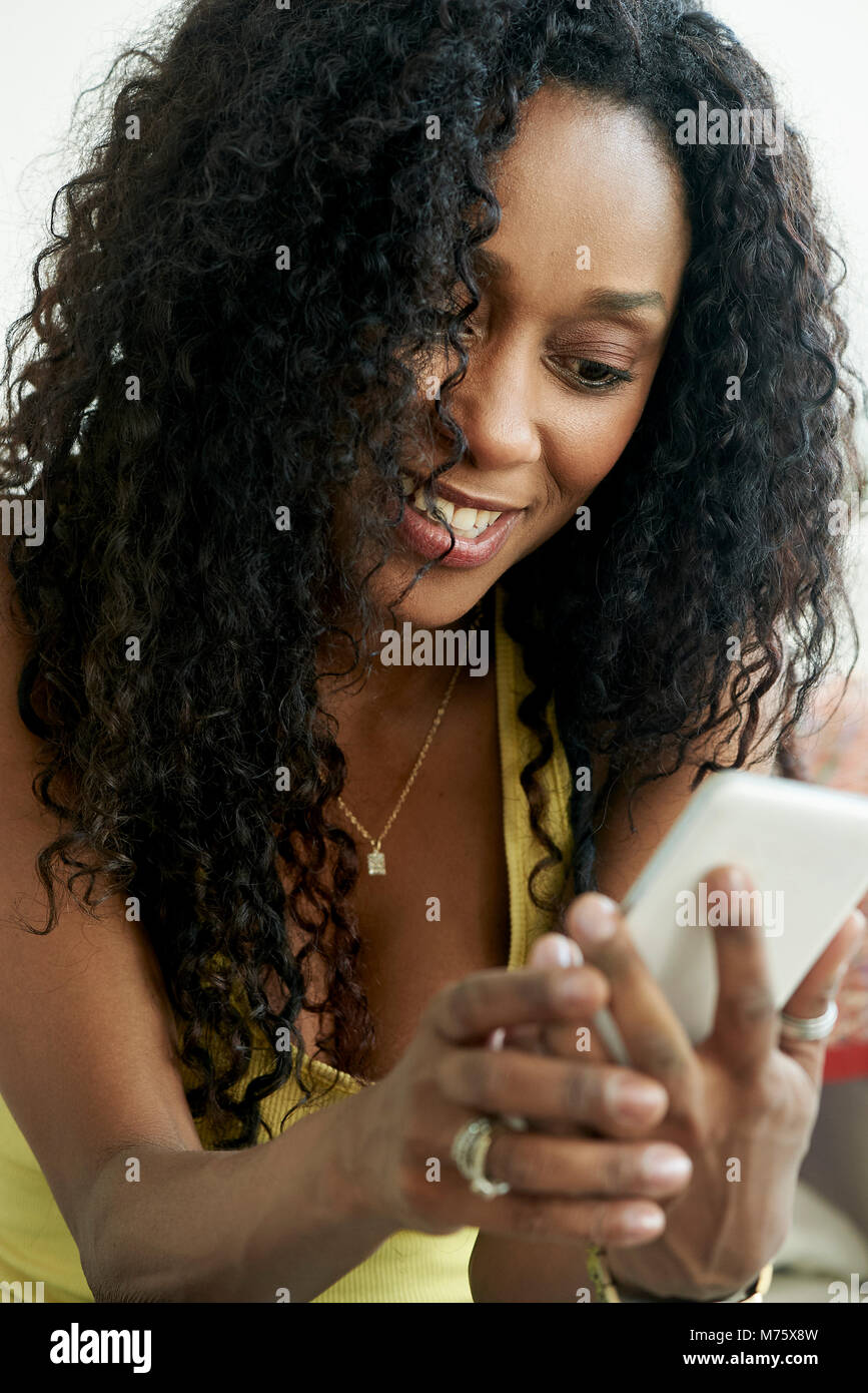 Woman using mobile phone Photo Stock