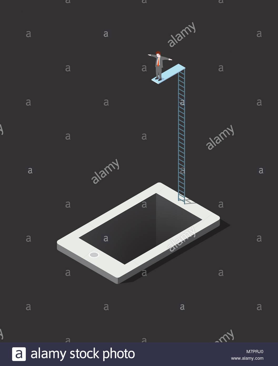Businessman on diving board sur le point de plonger dans tablet computer Photo Stock