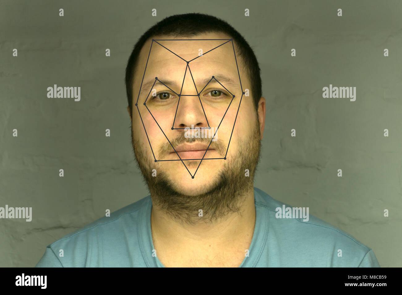La vérification biométrique de reconnaissance faciale - jeune homme ... 81b8345aa82
