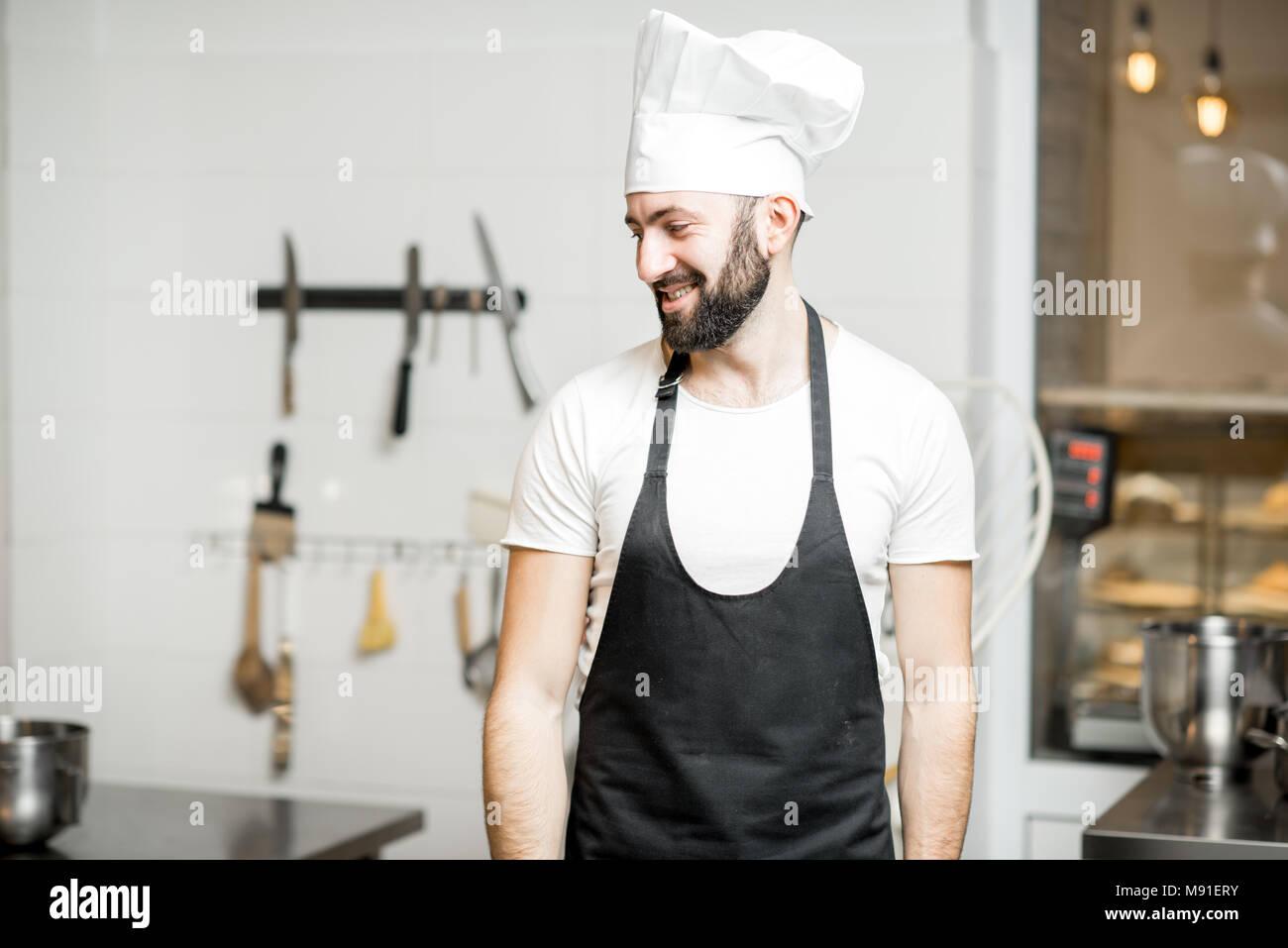 Chef cuisinier à la cuisine Photo Stock