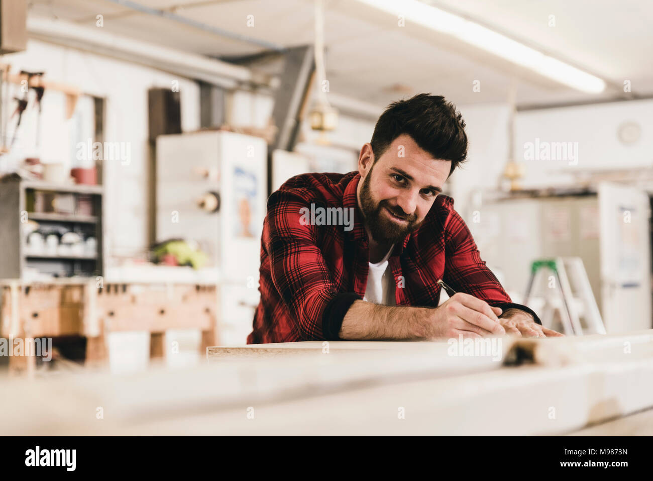 Portrait of smiling man in workshop Photo Stock