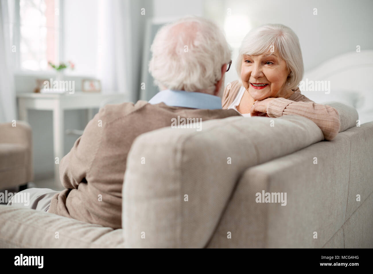 Senior woman looking at positive son mari face Photo Stock