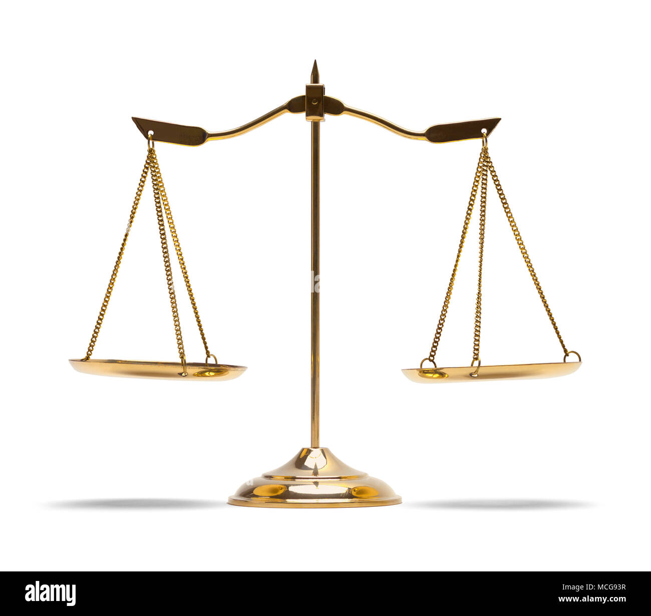 Les échelles de droit en laiton isolé sur fond blanc. Banque D'Images