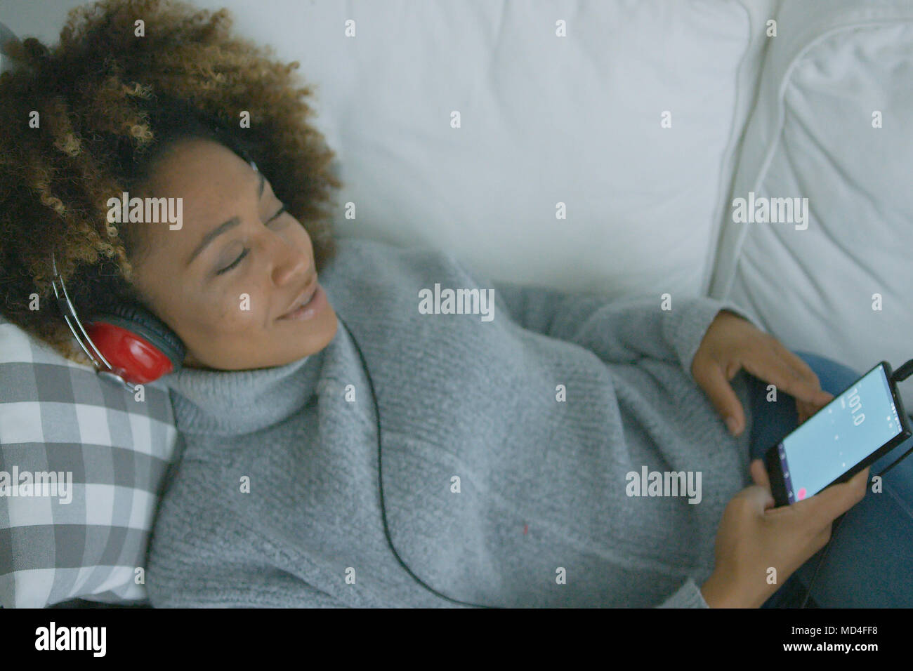 Content woman enjoying music Photo Stock