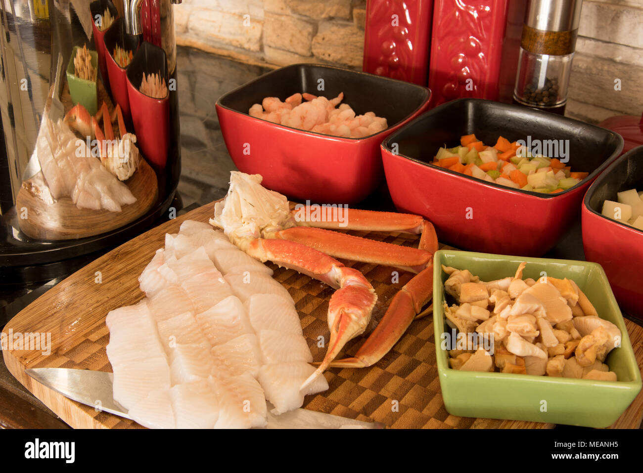 La préparation d'un délicieux classique et côte Est de la chaudrée de poisson Photo Stock